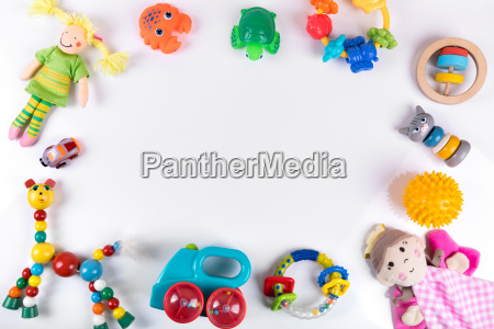 baby toys on white with copy