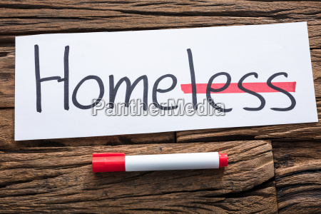 homeless text on paper with strike