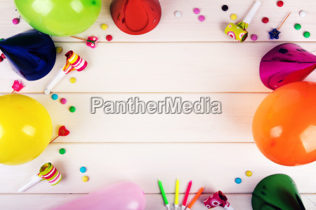 birthday party items on white wooden
