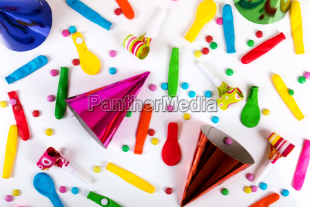 party accessories and decorations on white