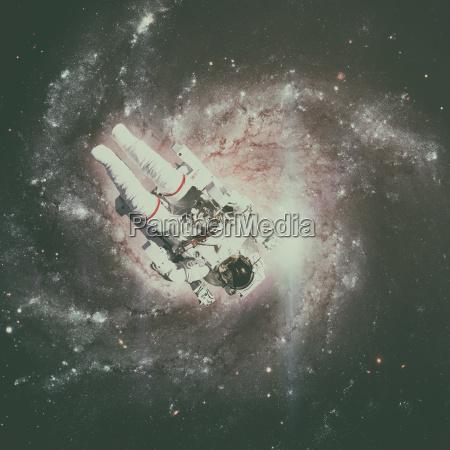 astronaut im weltraum spiralgalaxie auf dem