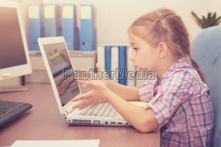 little girl doing homework on the