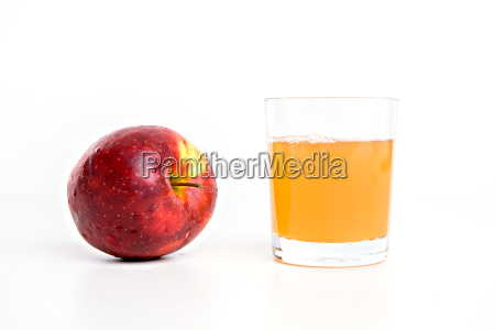 red apple with glass of naturally