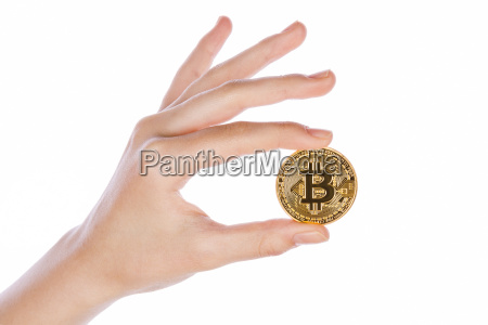 young girl hand holding bitcoin on