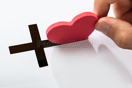 insert heart shape in crucifix slot