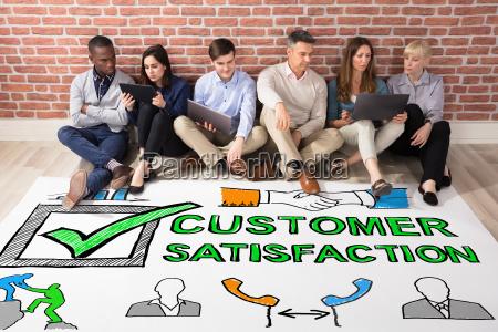 people looking at customer satisfaction survey