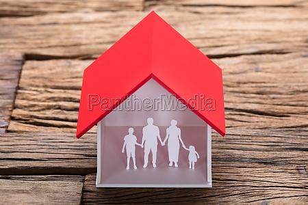 paper family in house model on