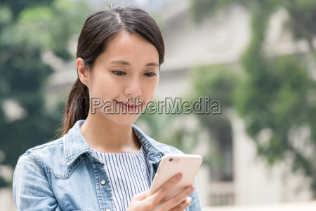 young woman watching on mobile phone