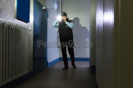 security guard with flashlight standing in