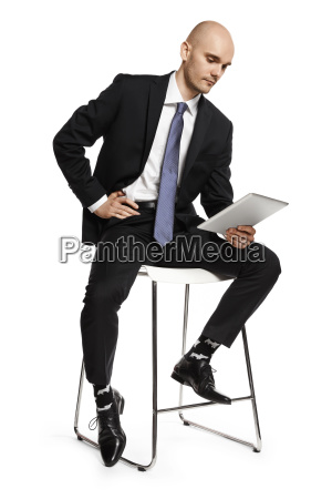 businessman reading from the digital tablet