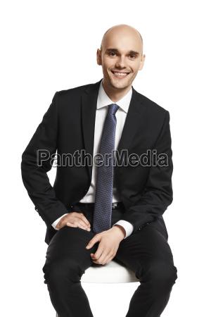 young elegant man sitting on a