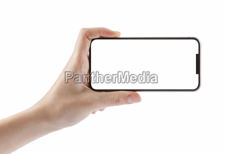hands holding black smartphone on white