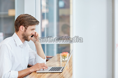 modern businessman multitasking