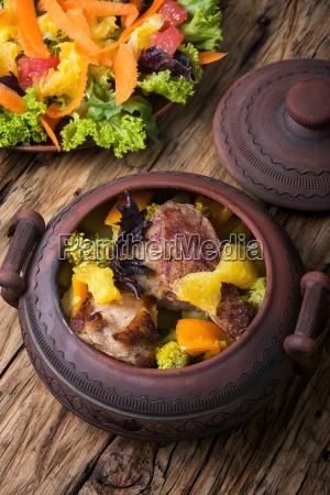 beef stew in ceramic pot