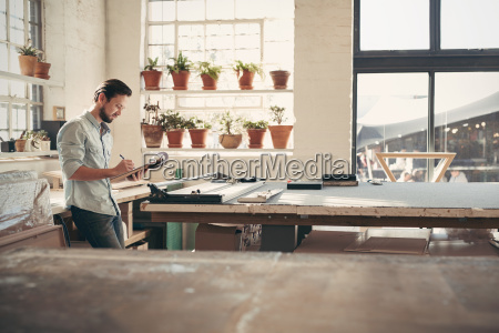 design business owner checking stock on