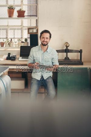 designer businessman in his studio using