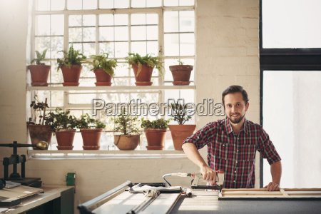 framer in his studio working with