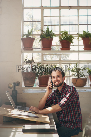 entrepreneur smiling at the camera from