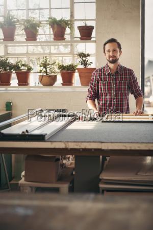 proud entrepreneur in his worshop studio