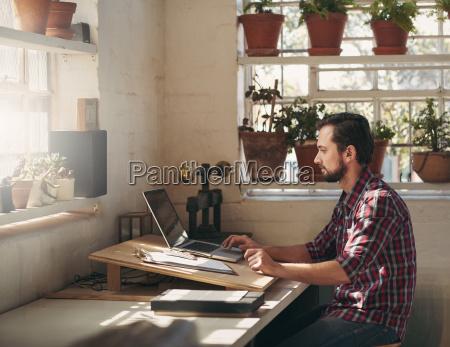 designer working on laptop in his