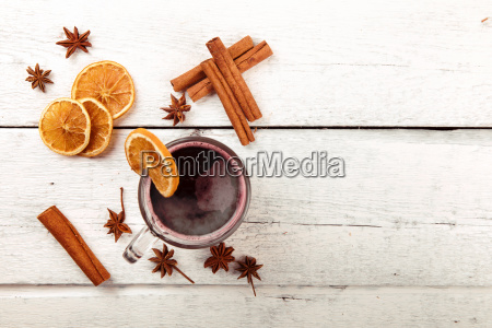 mulled wine with spices on white