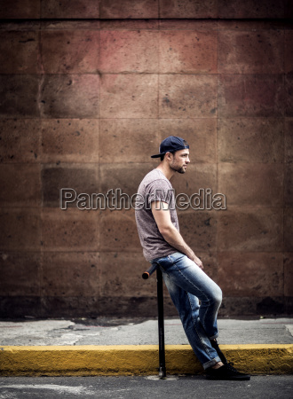 a man sitting on a piece