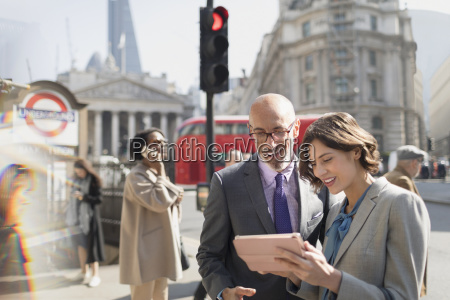 business people using digital tablet on