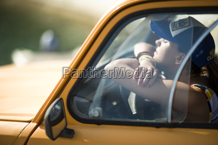 young woman sitting in the cab