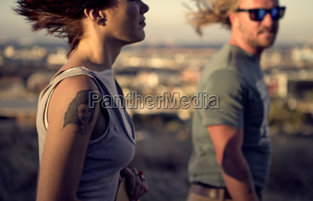 a young man and woman walking