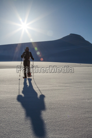 front view of man snowshoeing in