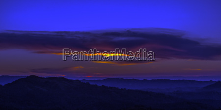 sky at sunset above hills in