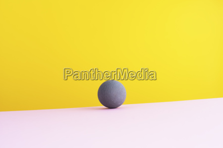 sphere against yellow background 3d rendering