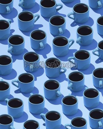 blue coffee mugs on light blue