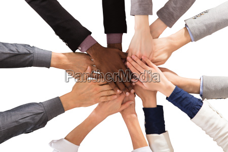 multi ethnic business people stacking hands