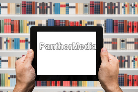 person hand holding digital tablet at