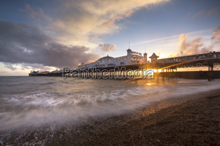 brighton pier at sunset with dramatic