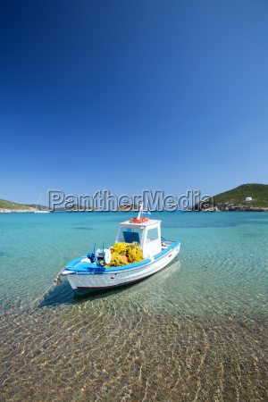 fishing boat moored on the beach