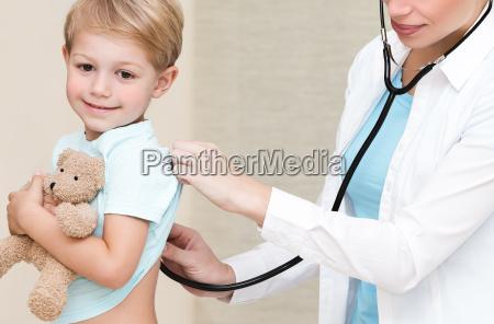 happy boy visiting doctor