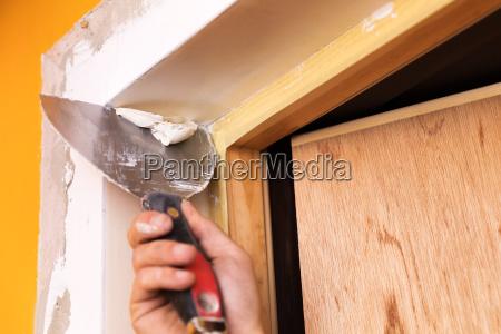 patching plaster around a new door