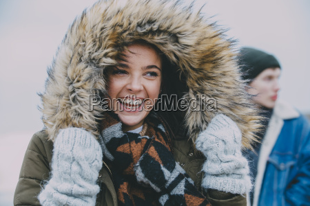 woman laughing on a winter beach