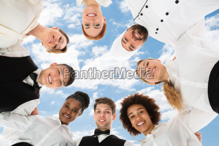 happy restaurant personal forming huddle