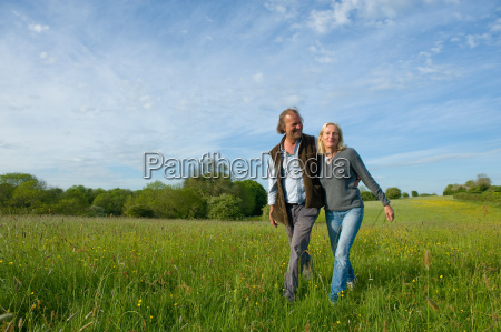 man and woman walking arm in