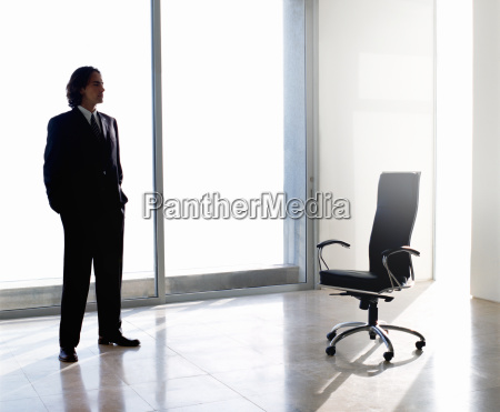 businessman wearing dark suit standing indoors