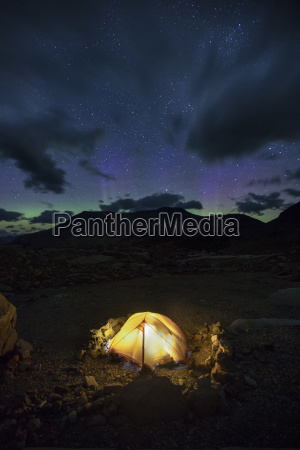 lit camping tent at night mount