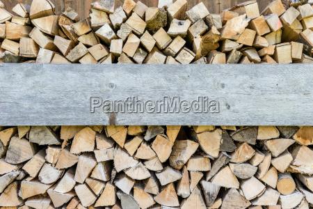 stacked firewood with text space