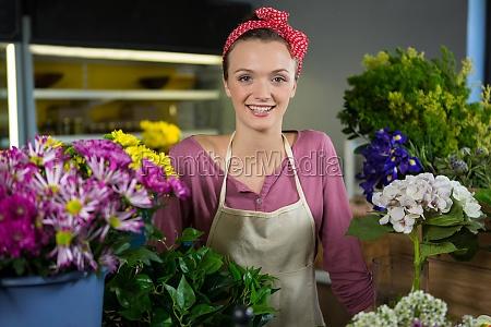 happy female florist standing in flower