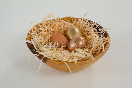 golden easter eggs in bowl