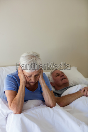 senior woman getting disturbed with man