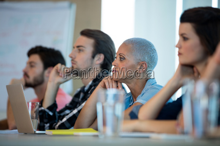 creative business team listening at meeting