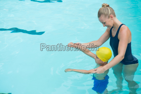 female instructor training young boy in